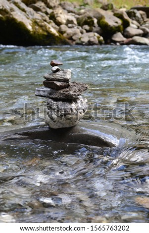 stacked stones in the river  #1565763202