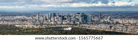 Panorama of  business district in Paris, France, on a cloudy autumn day #1565775667