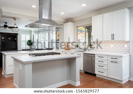 San Diego, CA / USA - 10/4/2019: Modern kitchen with white shaker cabinets #1565829577