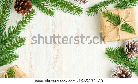Christmas and Happy New Year zero waste wooden background. Handmade gift Christmas box, fir branches, craft paper , top view, copy space. Ecofriendly plastic free concept #1565835160