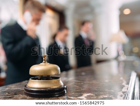 Hotel service bell Concept hotel, travel, room,Modern luxury hotel reception counter desk on background #1565842975