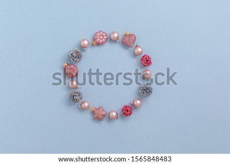 Christmas round frame from Natural cones and pink glass balls, Flat Lay, toned #1565848483