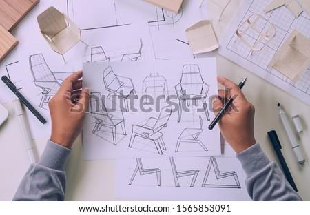 Designer sketching drawing design development product plan draft chair armchair Wingback Interior furniture prototype manufacturing production. designer studio concept .                            #1565853091