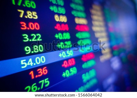 Blue stock exchange market graph on LED screen for business analysis. Finance and economic graphs.  #1566064042