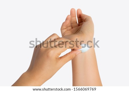 Woman applying the cotton to cover the wound, give a pressure to stop bleeding, wounds at the arm, clean the wound by cotton ball with alcohal methyl isolated on white background #1566069769