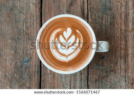 Coffee Latte Art - Tulip  A slightly rustic yet modern style image of a beautifully poured out latte coffee in the pattern known as a tulip.   #1566071467