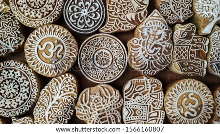 Artistic emblems on wooden pieces, symbolic background, from an antique shop, Fort cochin #1566160807