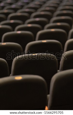 velvet seats for spectators in the theater or cinema #1566295705