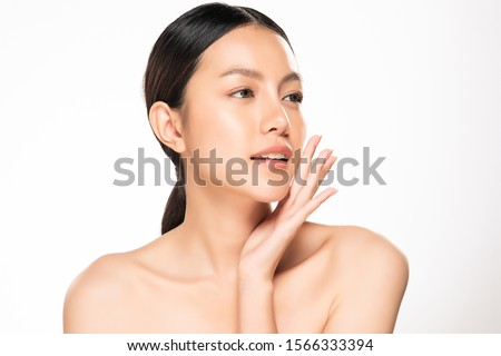 Beautiful young Asian woman touching soft cheek and smile with clean and fresh skin. Happiness and cheerful with, isolated on white background, Beauty and Cosmetics Concept, #1566333394