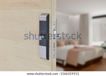 Digital door locking on wood door. Close up and selective focus. #1566359551