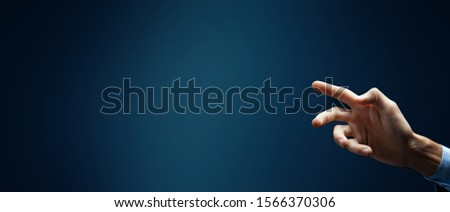 business man presses on touch screen #1566370306