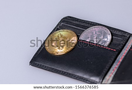 Golden bitcoin in leather wallet. Bitcoin with dollar in purse. Profit from mining crypto currencies. Miner with dollars and gold bitcoin. #1566376585