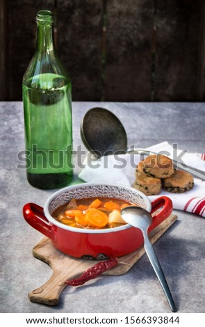 Hungarian goulash with scones and a bottle of water #1566393844