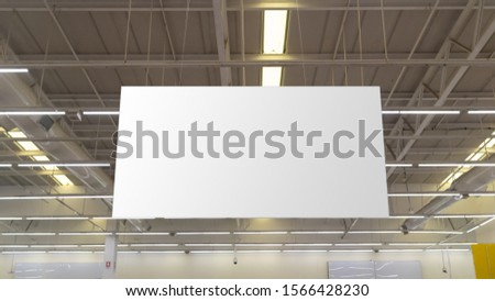 Blank advertising billboard hanging in the supermarket