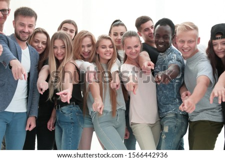 group of young people together pointing at something #1566442936