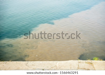 sewage flows into the river #1566463291