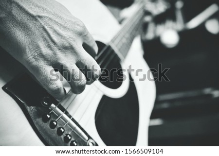 Closeup - Playing guitar - a little bit of grains in the pic