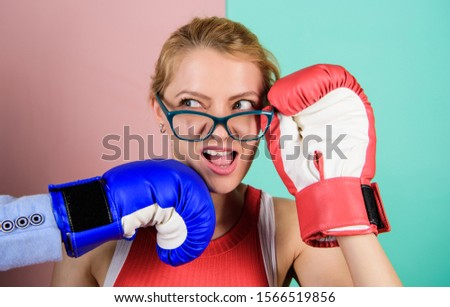Strong punch. Hand in boxing glove punching female face. Painful punch. Teeth pain concept. Defenseless head. Suffering. Punch in face. Destroy beauty. Cosmetology and plastic surgery services. #1566519856