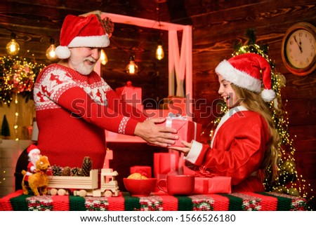 Santa Claus generous. Happiness and joy. Rewarding kindness. Santa bring gifts little girl. Cheerful celebration. Festive tradition. Child enjoy christmas with bearded grandfather Santa claus. #1566526180