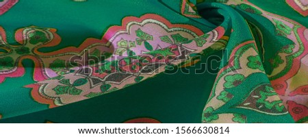 texture, background, multicolored silk fabric with a pattern of patterns on a green background, jacquard pattern #1566630814
