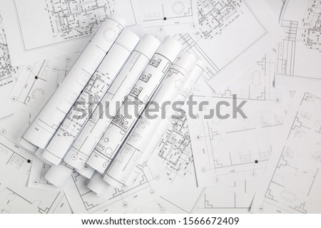 Paper architectural drawings and blueprint #1566672409