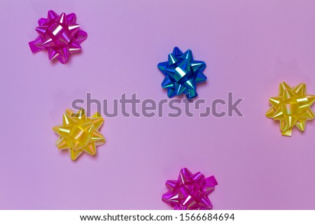 lots of bows on pink background. bows on a colored background. for postcards.Christmas tree decoration. space for text. the view from the top. 2020. #1566684694