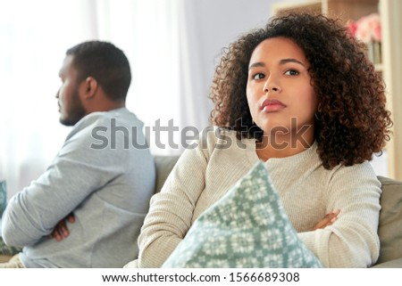 relationship difficulties, conflict and people concept - unhappy african american couple having argument at home #1566689308