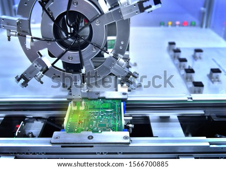 Technological process of soldering and assembly chip components on pcb board. Automated soldering machine inside at industria #1566700885