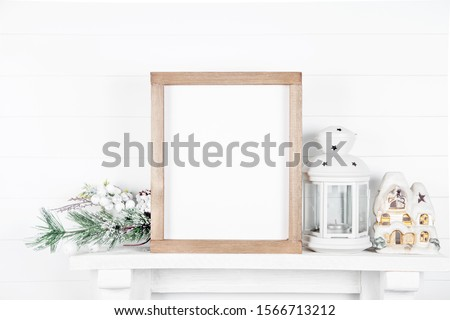 Mock up wooden frame on white wall background - Christmas template for your design #1566713212