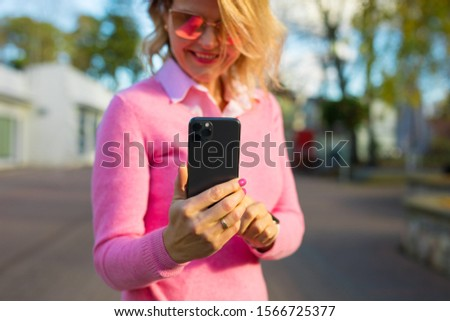 Woman using smartphone on the street