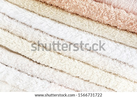 Background texture of soft cotton towels of pastel shades with a stack. The concept of softness, comfort and hygiene. Close-up, macro image. #1566731722