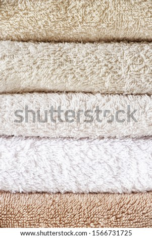 Background texture of soft cotton towels of pastel shades with a stack. The concept of softness, comfort and hygiene. Close-up, macro image. #1566731725