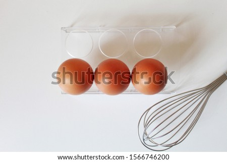 Three brown eggs in the kitchen