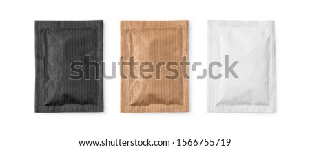 Small sugar packets isolated on white, with clipping path #1566755719