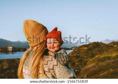 Cute baby and mother walking outdoor travel family vacations lifestyle mom and smiling child together Mothers day holiday #1566755839