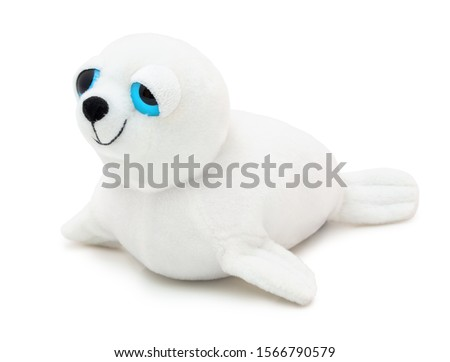 Cute seal doll with big blue eyes isolated on white background with shadow. Playful seal on white underlay. Plush stuffed puppet toy for children. Plaything for kids. Furry cute animal. #1566790579