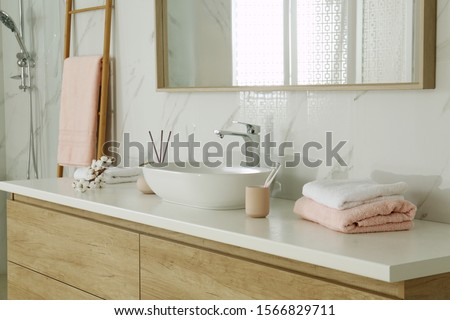 Large mirror over vessel sink in stylish bathroom interior Royalty-Free Stock Photo #1566829711