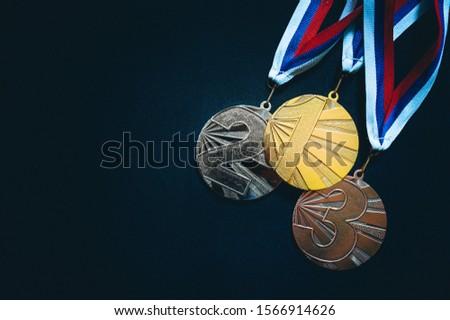Gold, silver and Bronze medal, black background. Summer game, Tokyo 2020 #1566914626