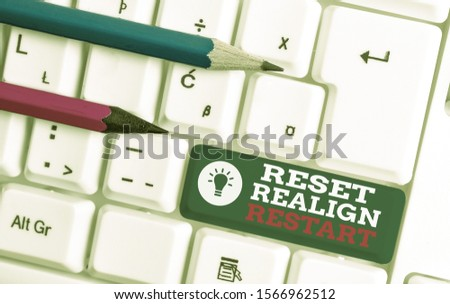 Text sign showing Reset Realign Restart. Conceptual photo Life audit will help you put things in perspectives White pc keyboard with empty note paper above white background key copy space. #1566962512