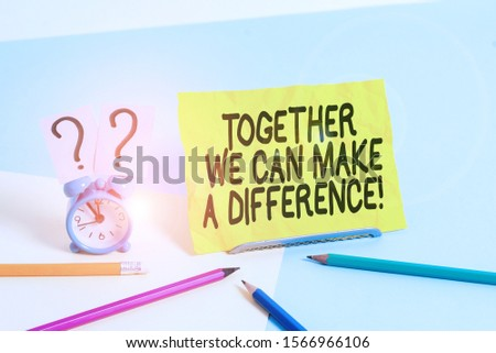 Text sign showing Together We Can Make A Difference. Conceptual photo be very important some way in like team or group Mini size alarm clock beside stationary placed tilted on pastel backdrop. #1566966106