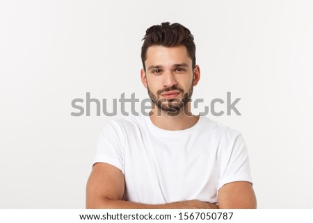 Portrait of smiling young man in a white t-shirt isolated on white background. #1567050787