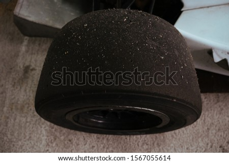 Sand on slicks tires on racing cars in garage #1567055614