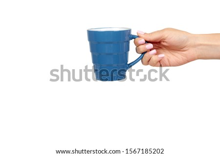 Hand with blue ceramic cup, mug for coffee and tea, kitchen pottery. Isolated on white background. Copy space template, mockup. #1567185202