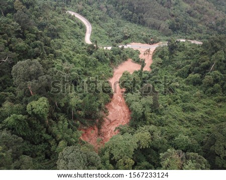 Heavy rain, and erosion caused of the landslide large masses of earth slip along slope of hill. #1567233124