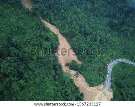 Heavy rain, and erosion caused of the landslide large masses of earth slip along slope of hill. #1567233127