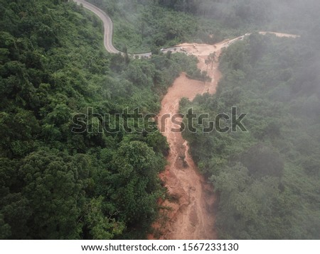 Heavy rain, and erosion caused of the landslide large masses of earth slip along slope of hill. #1567233130