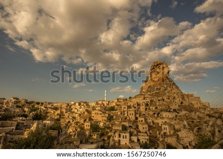 A low angle shot of an old ancient building scenery under the cloudy sky in Cappadocia, Turkey #1567250746
