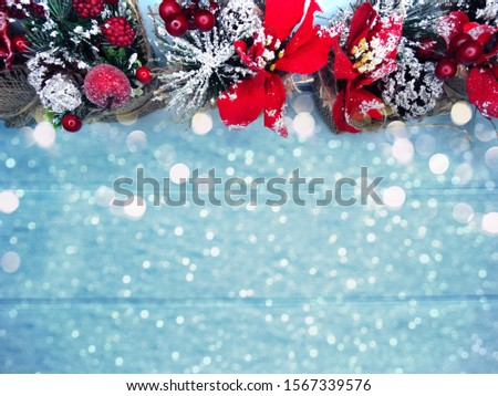 winter christmas background with fir branches cones and snow on blue wooden texture                               #1567339576