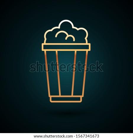 Gold line Popcorn in cardboard box icon isolated on dark blue background. Popcorn bucket box.  Vector Illustration #1567341673