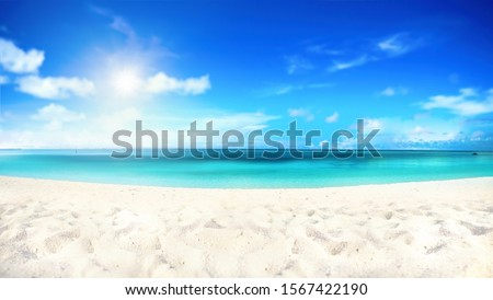 Beautiful beach with white sand, turquoise ocean water and blue sky with clouds in sunny day. Natural background for summer vacation, soft focus. #1567422190